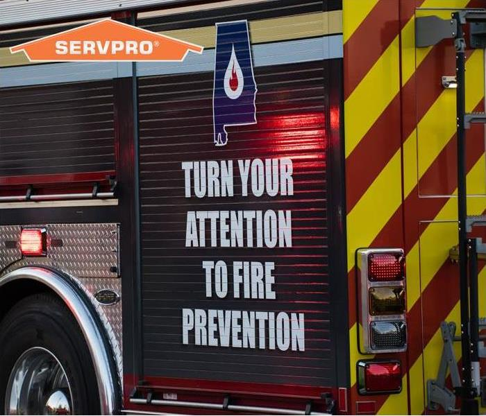 Turn your attention to fire prevention written on the side of a fire truck.